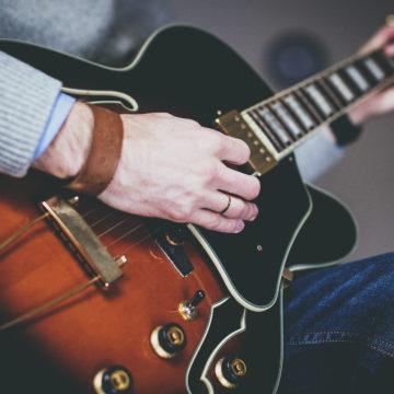 guitarist playing chord